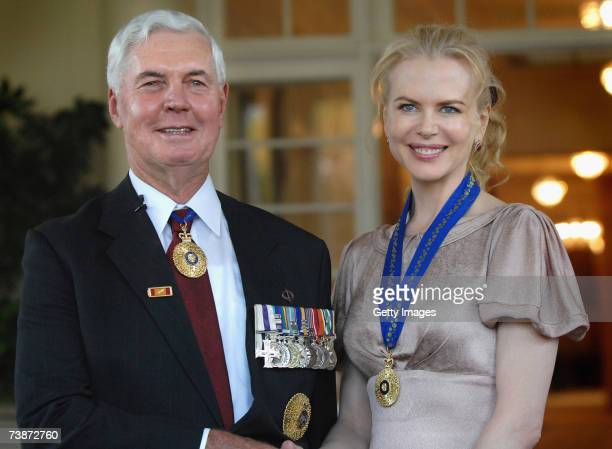 Actress Nicole Kidman receives her Companion in the General Division of the Order of Australia from the Governer General Michael Jeffery during a...