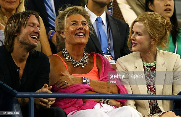 Actress Nicole Kidman shares a joke with her husband Keith Urban as they watch the men's singles second round match between Andy Roddick of the...