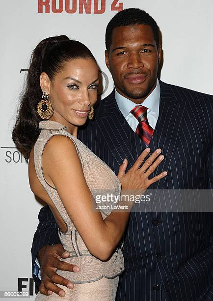 Actress Nicole Mitchell Murphy and NFL player Michael Strahan attend the premiere of Tyson at the Pacific Design Center on April 16 2009 in West...