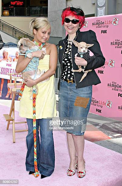 Actress Nicole Richie and her dog Honey Child with Fifi Romeo owner Yana Syrkin and her dog Yoda attend The Simple Life 2 Dog Fashion Show on May 27...