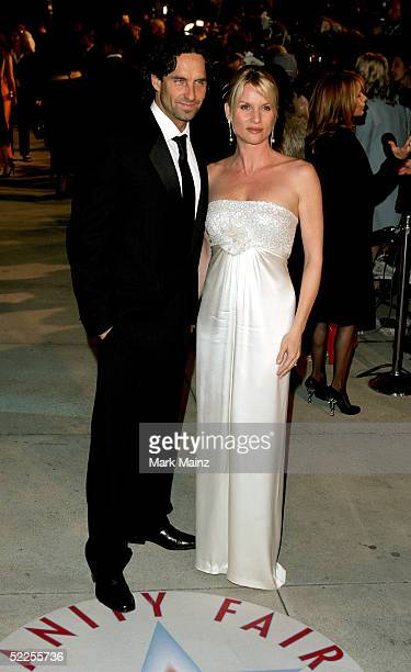 Actress Nicolette Sheridan and guest arrive at the Vanity Fair Oscar Party at Mortons on February 27, 2005 in West Hollywood, California.