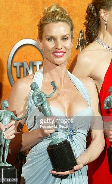 "Actress Nicolette Sheridan poses in the press room with the Actor for Outstanding Performance by an Ensemble in a Comedy Series for ""Desperate..."