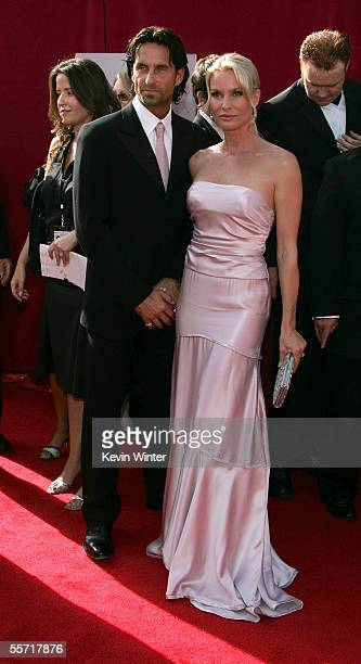 Actress Nicollette Sheridan and fiance Nick Soderblom arrive at the 57th Annual Emmy Awards held at the Shrine Auditorium on September 18 2005 in Los...