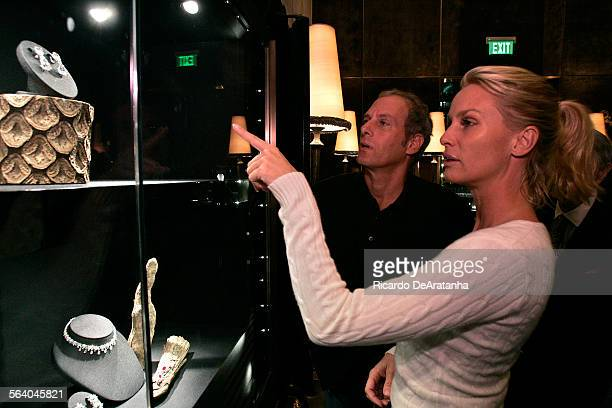Actress Nicollette Sheridan and singer Michael Bolton looking at a display during the opening party of Harry Winston America's premier fine jeweler...