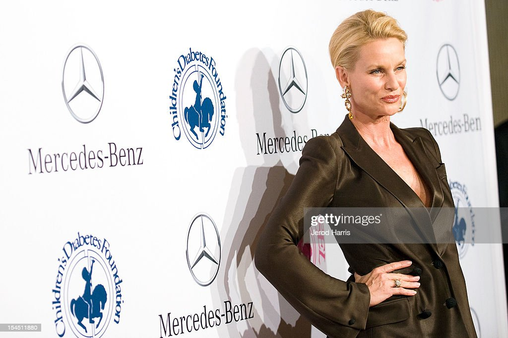 Actress Nicollette Sheridan arrives at Mercedes-Benz presents The Carousel Of Hope on October 20, 2012 in Los Angeles, California.