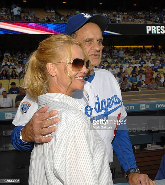 Actress Nicollette Sheridan poses with Los Angeles Dodger manager Joe Torre after throwing out the ceremonial first pitch prior to the Los Angeles...