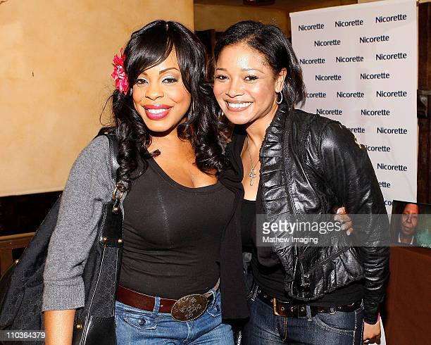 Actress Niecy Nash and actress Tamala Jones pose at the 2009 Nicorette Pre-Oscar Gift Suite Day 1 on February 18, 2009 in Los Angeles, California.