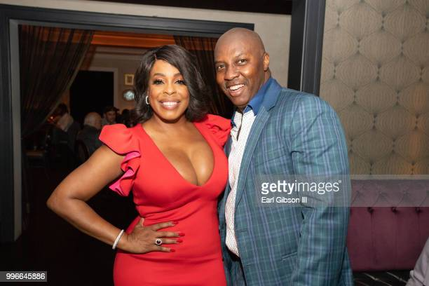 Actress Niecy Nash and celebrity event planner William P Miller pose for a photo at the afterparty to celebrate Niecy Nash's Star On The Hollywood...