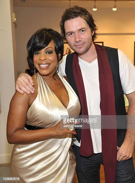 Actress Niecy Nash and musician Michael Johns attend the Style Network's Give and Get Feteevent at Frederic Fekkai on July 29 2009 in Beverly Hills...