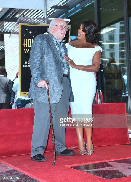 Actress Niecy Nash greets actor Ed Asner on her Hollywood Walk of Fame Star during a ceremony in Hollywood California on July 11 2018 Niecy Nash was...