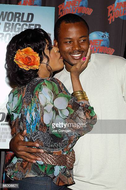 Actress Niecy Nash kisses a fan at Planet Hollywood June 4 2009 in New York City