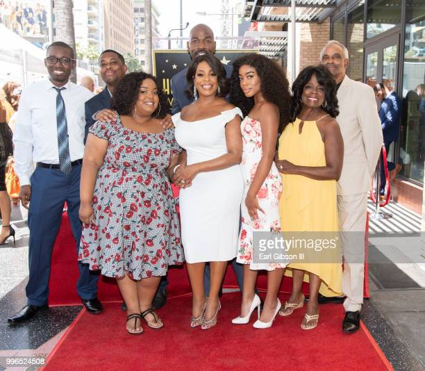 Actress Niecy Nash poses for a photo with her family as she receives her star on the Hollywood Walk Of Fame on July 11 2018 in Hollywood California