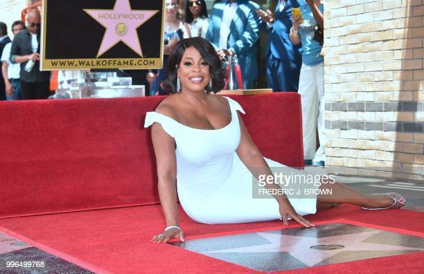 Actress Niecy Nash poses on her Hollywood Walk of Fame Star during a ceremony in Hollywood California on July 11 2018 Niecy Nash was the recipient of...