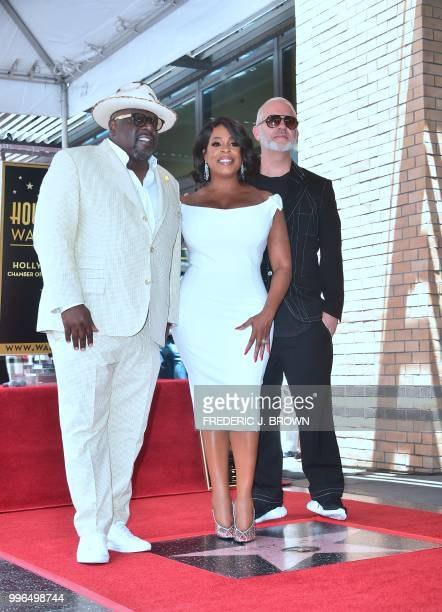 Actress Niecy Nash poses with Cedric 'The Entertainer' and Ryan Murphy on her Hollywood Walk of Fame Star during a ceremony in Hollywood California...