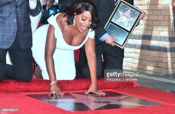 Actress Niecy Nash reacts and touches her Hollywood Walk of Fame Star during a ceremony in Hollywood California on July 11 2018 Niecy Nash was the...