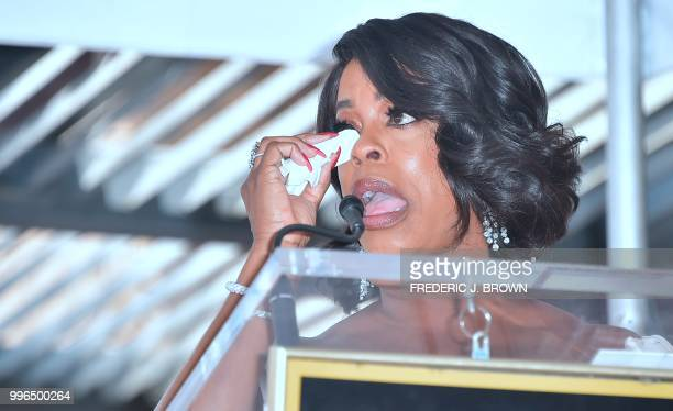 Actress Niecy Nash wipes a tear while speaking during her Hollywood Walk of Fame Star ceremony in Hollywood California on July 11 2018 Niecy Nash was...