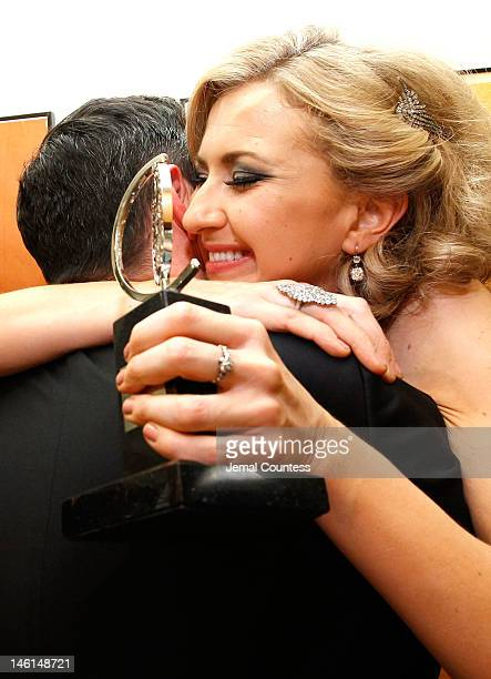 Actress Nina Arianda winner of Best Performance by a Leading Actress in a Play for 'Venus in Fur' poses in the 66th Annual Tony Awards press room at...