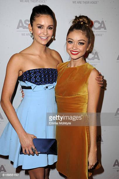 Actress Nina Dobrev and honoree Sarah Hyland attend ASPCA's Los Angeles Benefit on October 20 2016 in Bel Air California