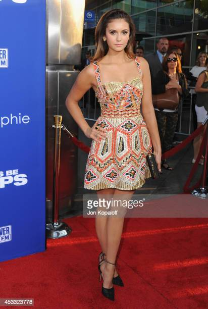 Actress Nina Dobrev arrives at the Los Angeles Premiere 'Let's Be Cops' at ArcLight Hollywood on August 7 2014 in Hollywood California