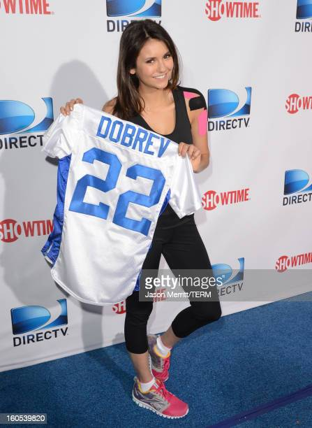 Actress Nina Dobrev attends DIRECTV'S Seventh Annual Celebrity Beach Bowl at DTV SuperFan Stadium at Mardi Gras World on February 2 2013 in New...
