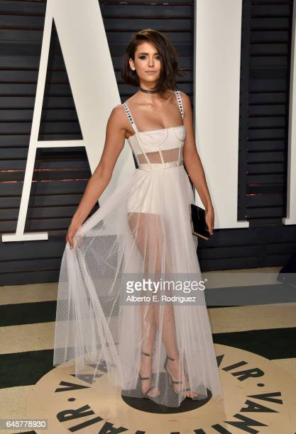 Actress Nina Dobrev attends the 2017 Vanity Fair Oscar Party hosted by Graydon Carter at Wallis Annenberg Center for the Performing Arts on February...