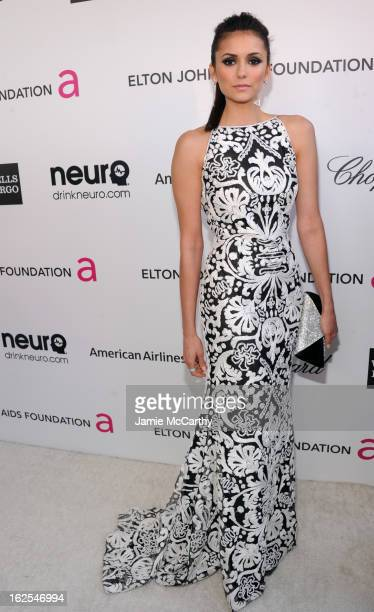 Actress Nina Dobrev attends the 21st Annual Elton John AIDS Foundation Academy Awards Viewing Party at West Hollywood Park on February 24 2013 in...