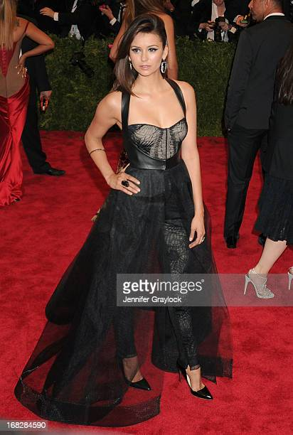 Actress Nina Dobrev attends the Costume Institute Gala for the PUNK Chaos to Couture exhibition at the Metropolitan Museum of Art on May 6 2013 in...
