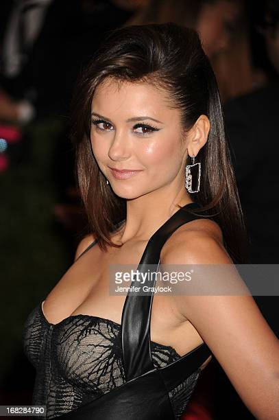 Actress Nina Dobrev attends the Costume Institute Gala for the 'PUNK Chaos to Couture' exhibition at the Metropolitan Museum of Art on May 6 2013 in...