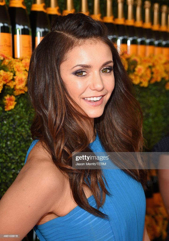 Actress Nina Dobrev attends the Sixth-Annual Veuve Clicquot Polo Classic at Will Rogers State Historic Park on October 17, 2015 in Pacific Palisades, California.