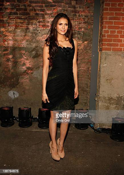 Actress Nina Dobrev poses backstage at the Christian Siriano Fall 2012 fashion show during MercedesBenz Fashion Week at The Studio at Lincoln Center...