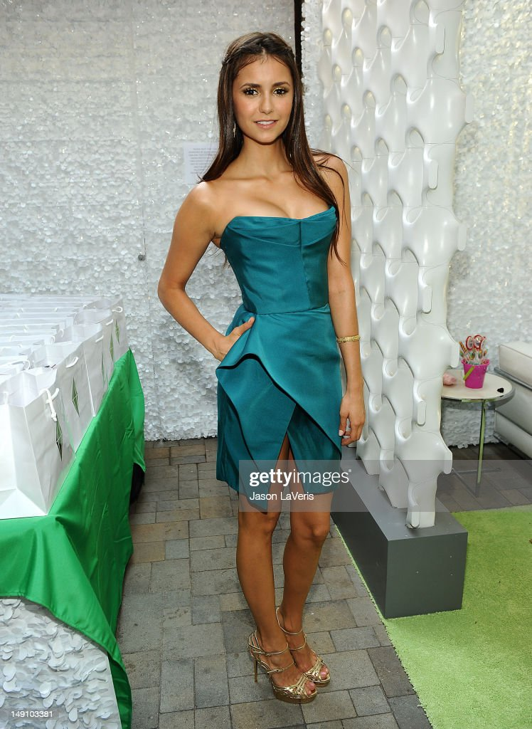 Actress Nina Dobrev poses in the green room at the 2012 Teen Choice Awards at Gibson Amphitheatre on July 22, 2012 in Universal City, California.