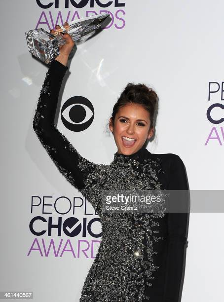 Actress Nina Dobrev poses in the press room during The 40th Annual People's Choice Awards at Nokia Theatre LA Live on January 8 2014 in Los Angeles...