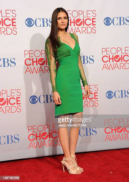 """Actress Nina Dobrev poses with Favorite TV Drama Actress Award for """"The Vampire Diaries"""" poses in the press room during the 2012 People's Choice..."""