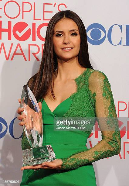 """Actress Nina Dobrev poses with Favorite TV Drama Actress Award for """"The Vampire Diaries"""" in the press room during the 2012 People's Choice Awards at..."""