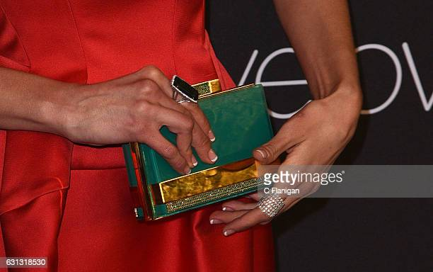 Actress Nina Dobrev purse detail arrives at the 18th Annual PostGolden Globes Party hosted by Warner Bros Pictures and InStyle at The Beverly Hilton...