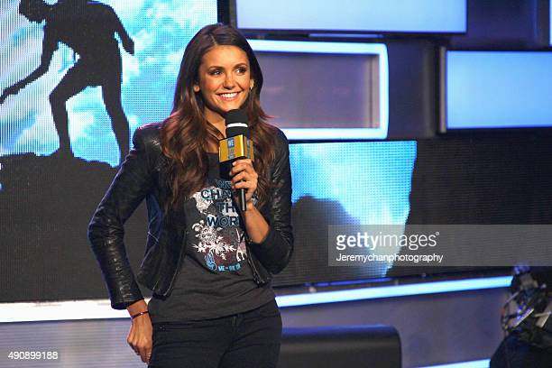 Actress Nina Dobrev speaks during WE Day Toronto at the Air Canada Centre on October 1 2015 in Toronto Canada