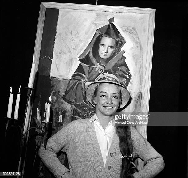 Actress Nina Foch poses at Pandora's Coffee House on Sunset Boulevard in Los AngelesCalifornia