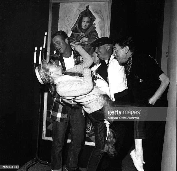 Actress Nina Foch poses with actor Gene Nelson producer Albert McCleery and actor Reginald Gardner at Pandora's Coffee House on Sunset Boulevard in...