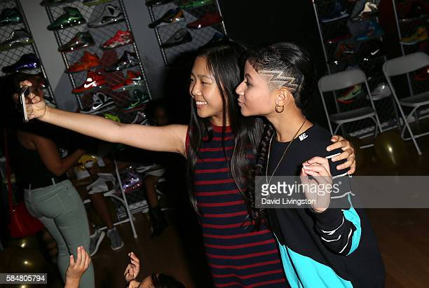 Actress Nina Lu and rapper Baby Kaely pose for a selfie at Baby Kaely's End of Summer Bash at The Mag Park on July 30, 2016 in Burbank, California.
