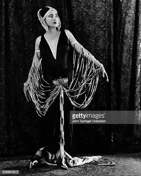 Actress Nita Naldi models the gown she wears in the 1923 film Lawful Larceny.