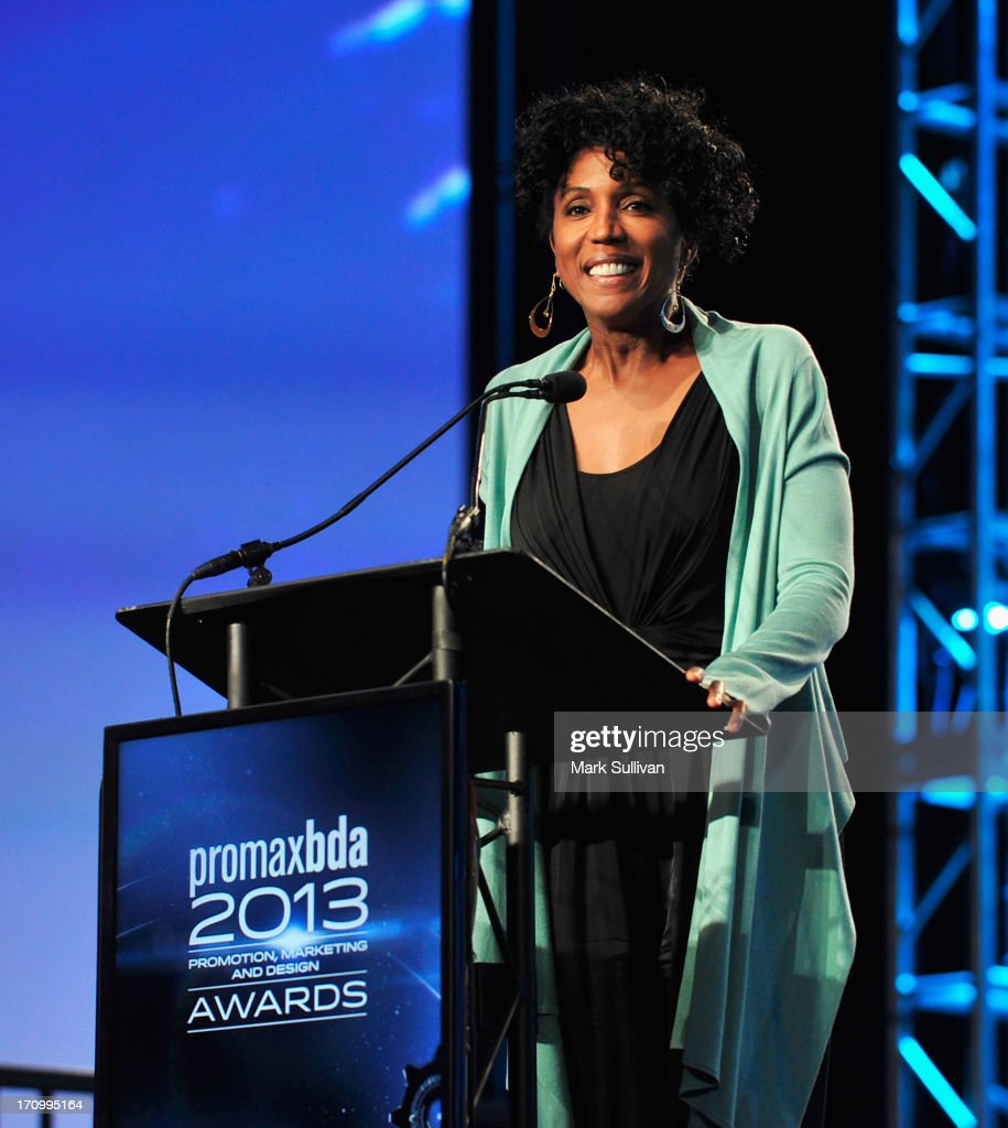 Actress Nita Whitaker introduces Mark Hamill before presenting him with the Don LaFontaine Award at the PromaxBDA Promotion, Marketing And Design Awards Show at JW Marriott Los Angeles at L.A. LIVE on June 20, 2013 in Los Angeles, California.
