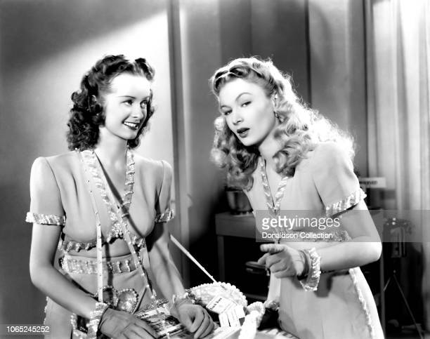 """Actress Noel Neill and Veronica Lake in a scene from the movie """"Bring on the Girls"""""""