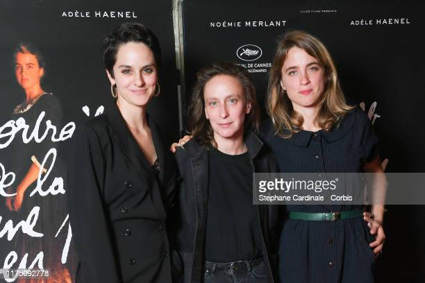 Actress Noemie Merlant director Celine Sciamma and actress Adele Haenel attend the Premiere of 'Portrait de la Jeune Fille En Feu' at UGC Les Halles...