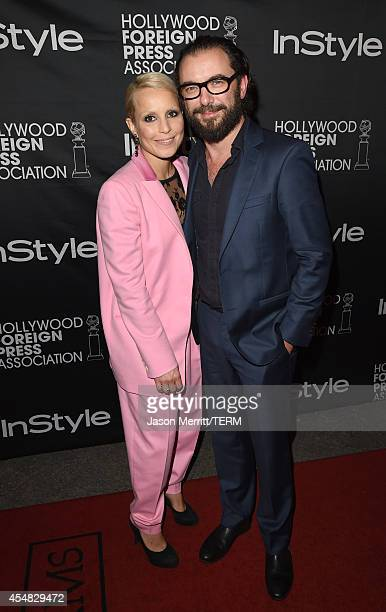 Actress Noomi Rapace and Director Michael R Roskam attend HFPA InStyle's 2014 TIFF celebration during the 2014 Toronto International Film Festival at...