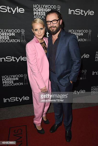 Actress Noomi Rapace and Michael R Roskam attend HFPA InStyle's 2014 TIFF celebration during the 2014 Toronto International Film Festival at Windsor...