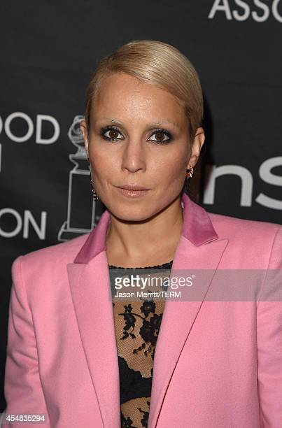 Actress Noomi Rapace attends HFPA InStyle's 2014 TIFF celebration during the 2014 Toronto International Film Festival at Windsor Arms Hotel on...