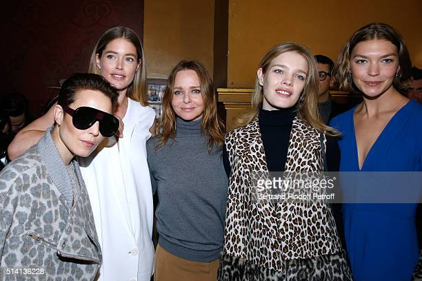 Actress Noomi Rapace Model Doutzen Kroes Stylist Stella McCartney Model Natalia Vodianova and Arizona Muse pose backstage after the Stella McCartney...