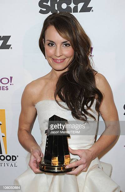 Actress Noomi Rapace poses with the Hollywood Spotlight Award during the 14th annual Hollywood Awards Gala at The Beverly Hilton Hotel on October 25...