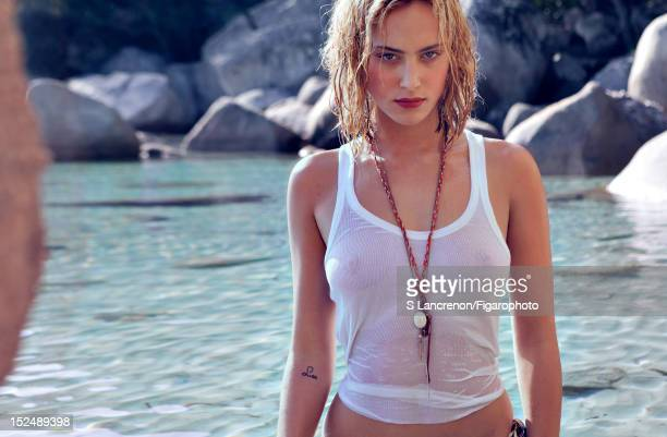 Actress Nora Arnezeder poses for Madame Figaro on June 18 2012 in Corscia France Figaro ID 103882024 Tank top by Zadig Voltaire necklaces by Medecine...