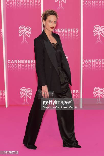 Actress Nora Arnezeder poses on the pink carpet prior to the closing ceremony of the 2nd Canneseries International Series Festival on April 10 2019...